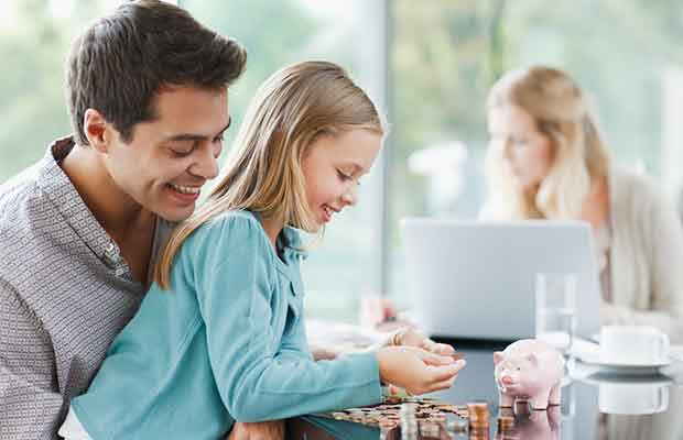 Father teaching daughter about money