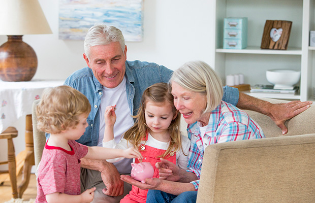 Grandparents teaching grandchildren about money