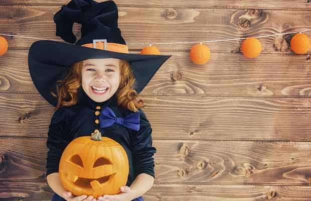 Child dressed as a witch