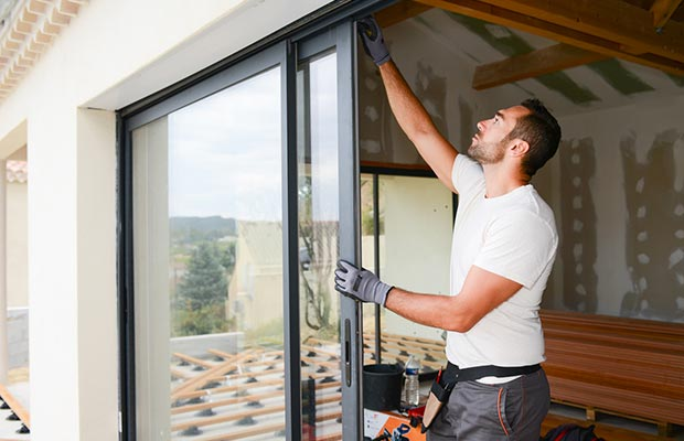 Man Installing Glass Door