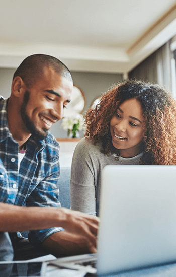 Couple-looking-at-laptop-computer
